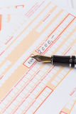 Fountain Pen on Remittance slip Royalty Free Stock Images
