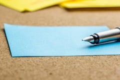 Fountain pen on a sheet of blue paper Stock Photos