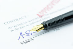 Fountain pen with a signature on an approved contract. Stock Images