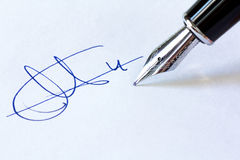Fountain Pen and Signature. Close up shot of a fountain pen and a signature  on white background Stock Image
