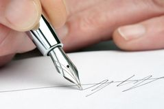 Fountain pen with signature stock photography
