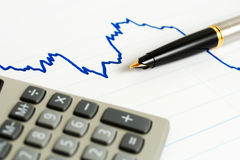 Fountain pen and stock index. Stock Photo