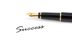 Fountain pen and success text Stock Images