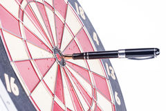 Fountain pen in the target center of dartboard Royalty Free Stock Image