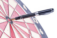 Fountain pen in the target center of dartboard Stock Images