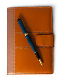 Fountain pen on top of the closed notebook top view Stock Images