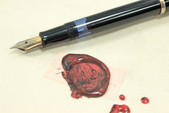 Fountain pen and wax seal Royalty Free Stock Image