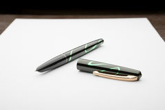 Fountain Pen on White Paper Royalty Free Stock Photography