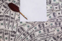 Fountain pen, white sheet of paper on background of money Stock Photo
