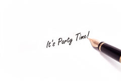 Fountain Pen Writing. A photo of a fountain pen writing It's Party Time in black ink. The pen and ink are isolated on a white background Stock Photography