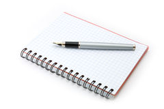 Fountain pen and writing-book. On a white background royalty free stock images
