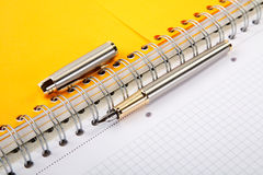 Fountain pen and  writing-book on a spiral Royalty Free Stock Photo