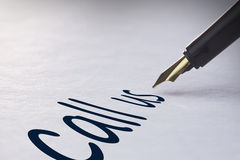 Fountain pen writing Call us Royalty Free Stock Photo