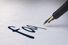 Fountain pen writing Faq Royalty Free Stock Photo