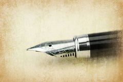 Fountain pen writing on the paper Royalty Free Stock Photo