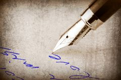 Fountain pen writing on the paper, Royalty Free Stock Images