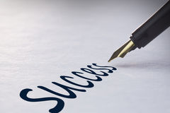 Fountain pen writing Success Stock Photos