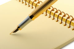 Fountain pen on a yellow notebook Royalty Free Stock Image