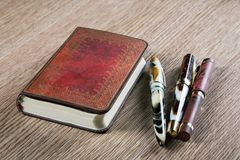 Fountain pens and diaries. With leather cover Royalty Free Stock Photos