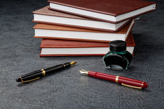 Fountain pens with ink and organizers Stock Photography