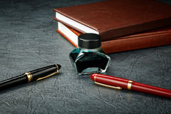 Fountain pens with ink and organizers Royalty Free Stock Photos