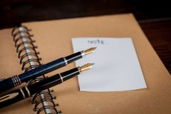 fountain pens over a dairy book Royalty Free Stock Photo