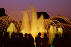 Fountain with people silhouettes Stock Images