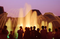 Fountain with people silhouettes Royalty Free Stock Image