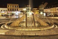 Fountain on Piata Sfatului in Brasov. Romania Stock Photography