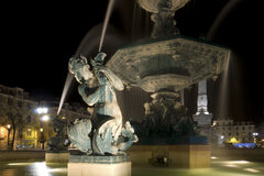 Fountain in the Piazza. Night shot, a typical European fountain in a plaza. This is Lisbon Royalty Free Stock Photography