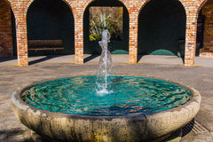 Fountain with pillars in the back gorund Royalty Free Stock Photos