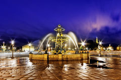 Fountain at Place de la Concord in Paris  by dusk. France Stock Images