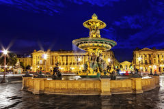 Fountain at Place de la Concord in Paris  by dusk. France.  Stock Photos