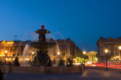Fountain at Place de la Concord in Paris. Fountain at Place de la Concord by dusk in Paris, France Stock Photo