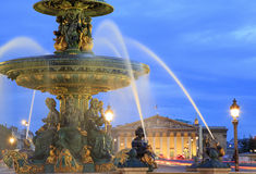 Fountain on Place de la Concorde in Paris at dusk Royalty Free Stock Photography