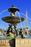 Fountain on Place de la Concorde in Paris with visible obelisk Royalty Free Stock Photo