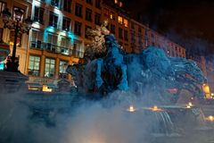 Fountain on Place des Terreaux during Festival of Lights royalty free stock photo
