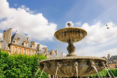 Fountain on Place des Vosges. One of the foutains on the square Place des Vosges in Paris, France Royalty Free Stock Image