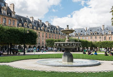 Fountain in Place des Vosges, Paris Royalty Free Stock Images