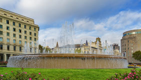 Fountain at the Plaza de Catalunya in Barcelona , Spain. Fountain with flowers in the foreground at the Plaza de Catalunya in Barcelona , Spain stock photos
