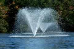 Fountain on a pond Stock Photography