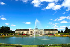 Fountain and pond in front of royal palace Stock Photo