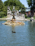 Fountain Pond, Tower Grove Park. Pictured is the Fountain Pond in Tower Grove Park, Saint Louis, Missouri.  The fountain is three tiered.   Along the edge of the Stock Image