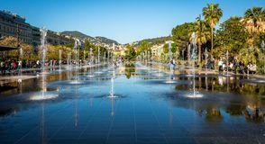 Fountain at Promenade du Paillon, Nice, France. Reflections in the surface water on the fountain at Promenade du Paillon , Nice, France stock photography