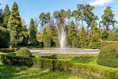 The fountain in the public park of Estense Palace in Varese, Italy. The fountain in the public park of Estense Palace Palazzo Estense in Varese, Italy Royalty Free Stock Photography