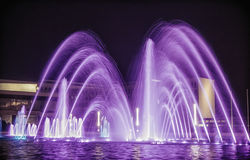 A Fountain. A purple fountain by night Royalty Free Stock Photography