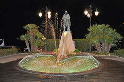 Fountain on quay of Amalfi by night. Lit by a lantern Stock Image