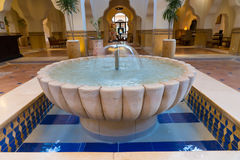 Fountain in аrabic style with small tiles in the lobby Stock Photography