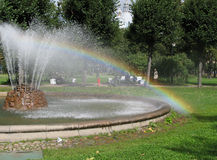 Fountain and rainbow. In public garden near Smolny cathedral in Saint-Petersburg Stock Photography