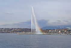 Fountain and rainbow on Geneva lake Stock Photo